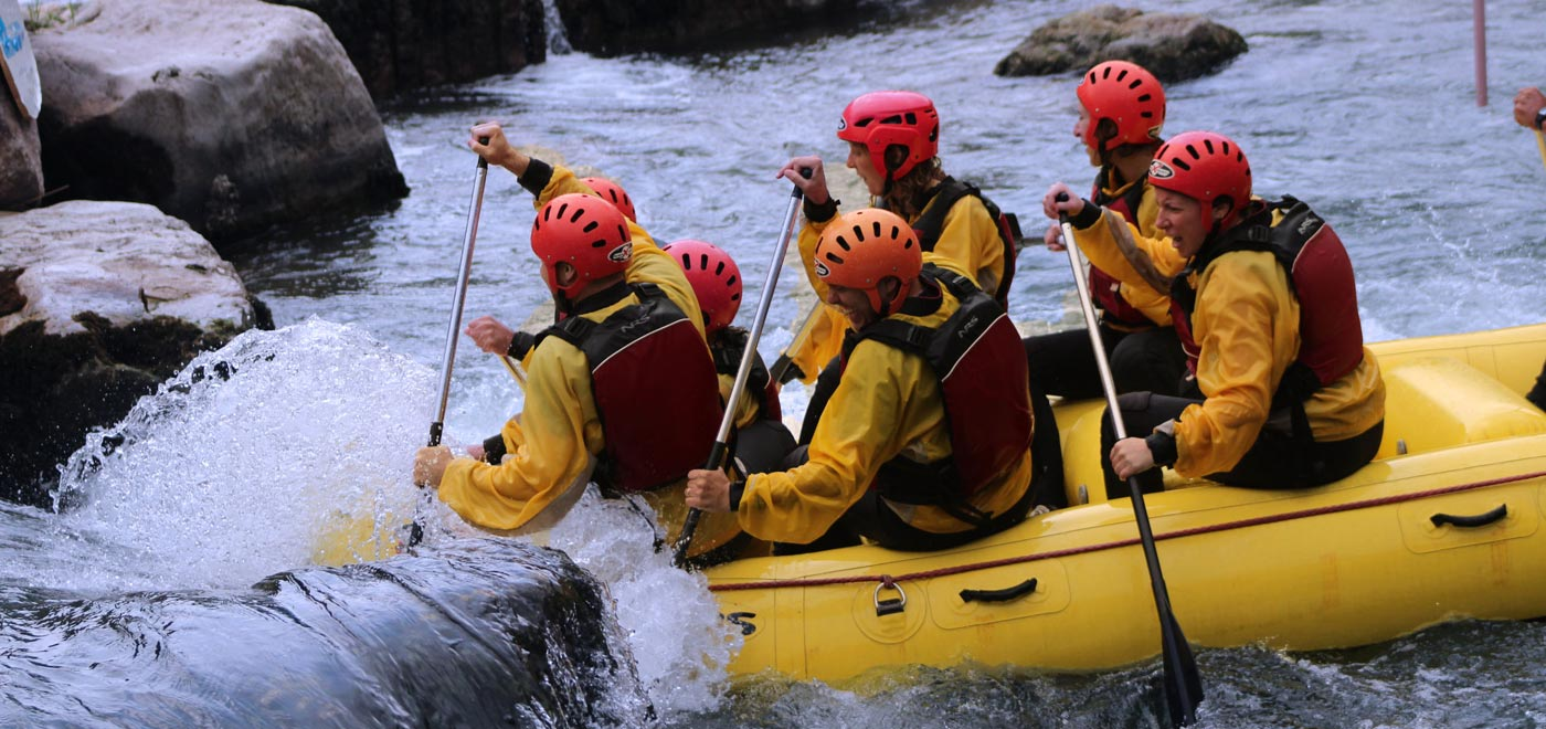 A group of people rafting on river Brenta