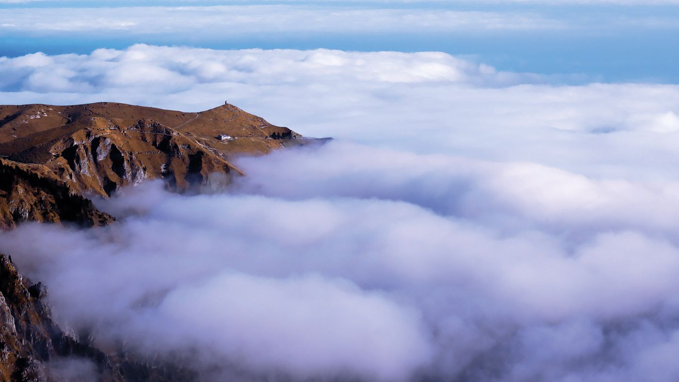 Aerial view of Monte Grappa surrounded by clouds